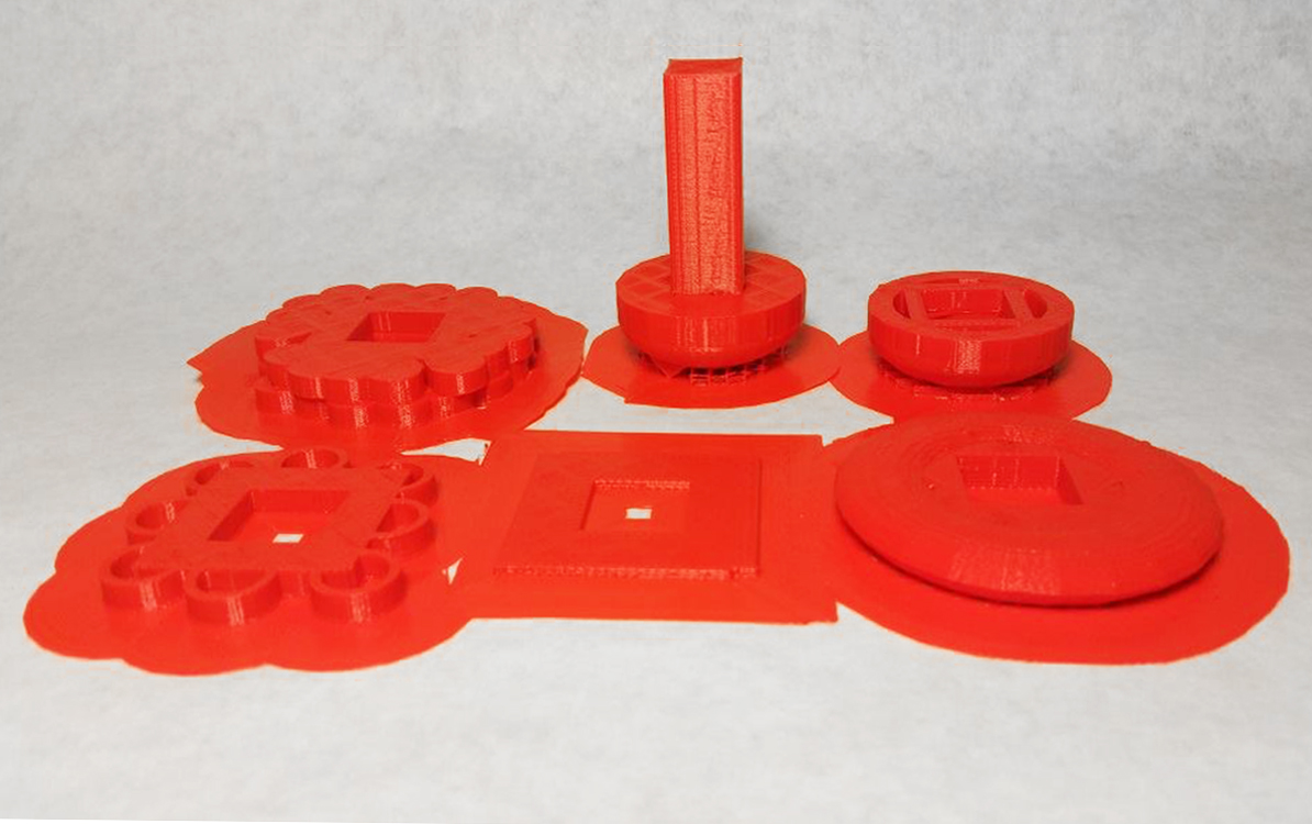 Deconstructed hamburger 3D printed in red PLA filament